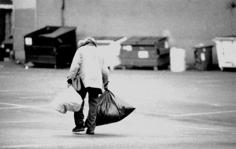 Photo of homeless man with many bags
